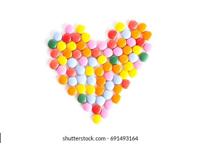 Heart shape made from colorful button-shaped candies