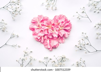 Heart shape made of flowers on white background.Flat lay. Valentines,love and wedding concept ideas