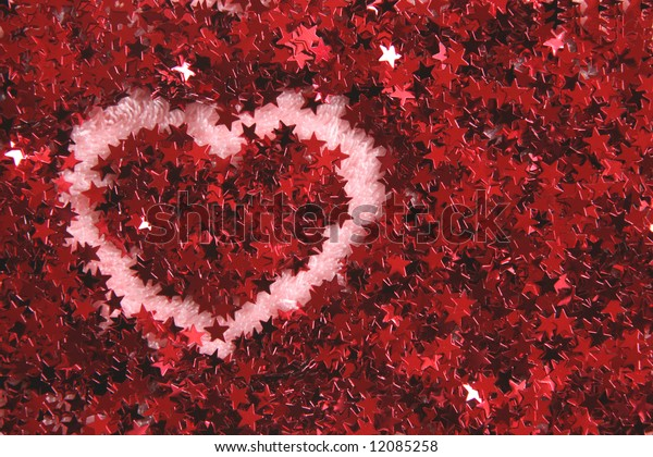 Heart shape made in red shiny stars