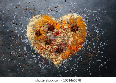 Heart shape made from spices on slate background