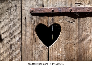heart shape at an old wooden door of a toilet in Germany