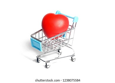 Heart shape on shopping trolley. Concept image.