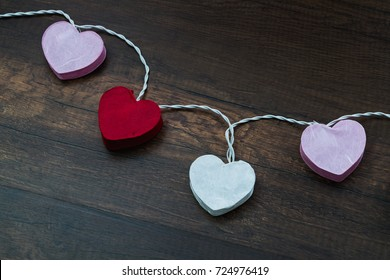 Heart shape paper lamp for decoration place on wooden floor