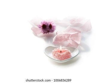 heart shape pink rose candle with flowers on white background