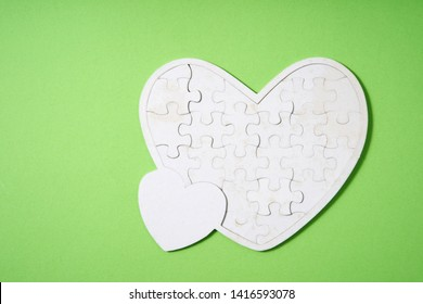 heart shape puzzle on the green background