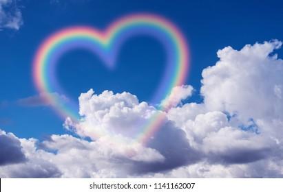 Heart shape rainbow in the sky.