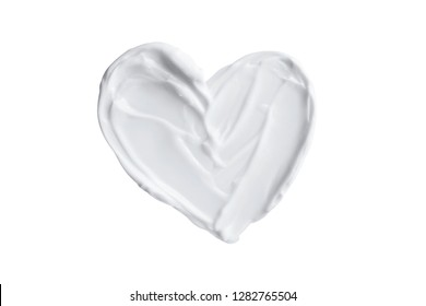 Heart shape from skincare cream or yogurt isolated on white background valentine's day creative concept