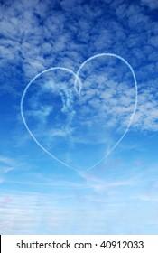 Heart shape skywritten against a blue summer sky by Red Arrows display team