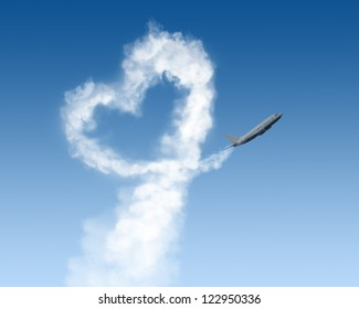 heart shape track from plane on blue background