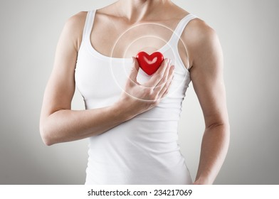 Heart shape in woman's hands. Cardiovascular medicine. Heart or pulse rate concept.