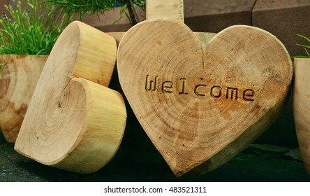 Heart shape wooden cutting board with welcome text carved/engraved