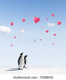 heart shaped Balloons flying over Emperor penguins in Antarctica