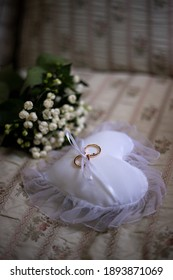 heart shaped bearing with wedding rings