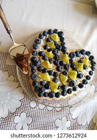 Heart shaped cake with  bluberries and lime