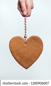 Heart shaped christmas gingerbread cookie on white background