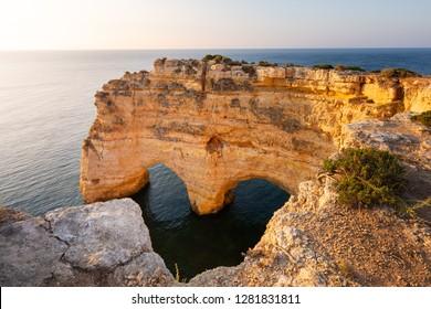 Heart shaped cliff in Algarve, Praia Marinha, Portugal