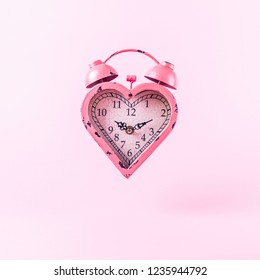 Heart shaped clock on pink background.  Valentines day and love infitity and duration concept. Square