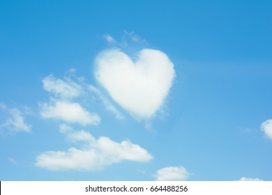 Heart shaped cloud, blue sky background