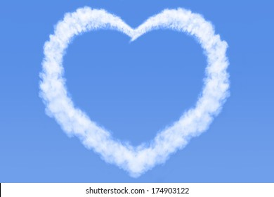 A heart shaped cloud in a bright blue sky. Copy space for your own message.