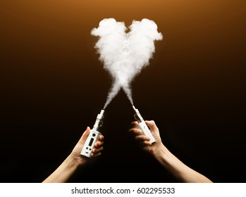 heart shaped cloud isolated on black. Heart sign is made of two puffs. Vape