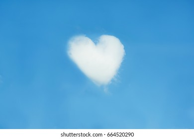 Heart shaped cloud isolated on blue sky