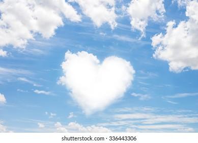 Heart shaped cloud on blue sky background