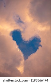 Heart shaped clouds in the blue sky. The heart is made with an image editing Program.