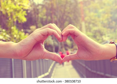 Heart shaped composed of couple hand being together in vintage style concept of love in Valentine day, take care, soul mate and feeling healthy