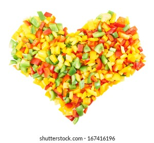 Heart shaped composition of sliced colorful sweet bell peppers isolated over a white background