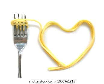 Heart shaped cooked capellini spaghetti with fork isolated on white background