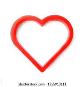 Heart shaped cookie cutter on white background, top view