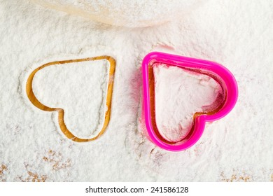 heart shaped cookie cutter on flour