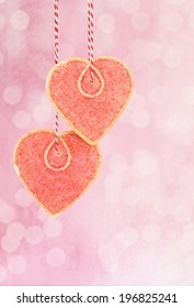 Heart shaped cookie ornament hanging with bakers string