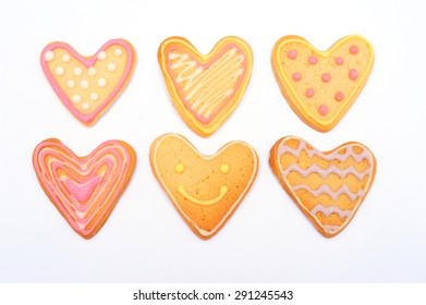 Heart shaped cookie with pink sugar icing isolated on white background