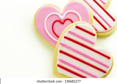 Heart shaped cookies decorated fancy icing patterns.