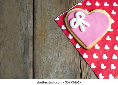 Heart shaped cookies made by hand on old wooden table.