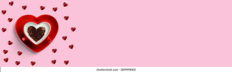 . Heart shaped cup with coffee surrounded by small hearts isolated on pink background. Coception until Valentine's Day.