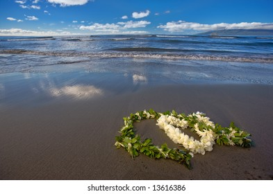 Heart shaped flower lei and leaf garland (wedding leis) on a tropical beach
