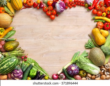 Heart shaped food / food photography of heart made from different fruits and vegetables on wooden table