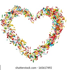 Heart shaped frame card made from colored sprinkles close up isolated on white background