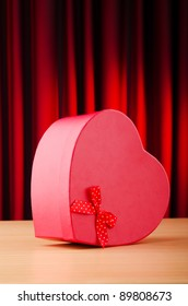 Heart shaped gift box against background