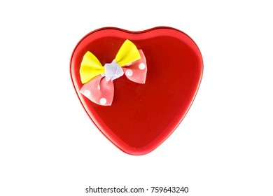 heart shaped gift box with bow isolated on a white background - clipping paths