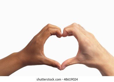 Heart shaped hand gesture from two different race people