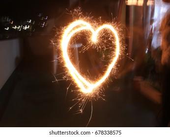 Heart shaped handy fireworks in a balcony.