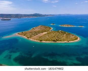 Heart shaped island of Galesnjak in Zadar archipelago aerial view, Dalmatia region of Croatia