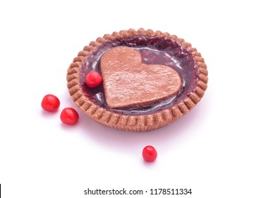 heart shaped jam cookie pie and berries isolated