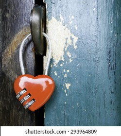 heart shaped lock with old door