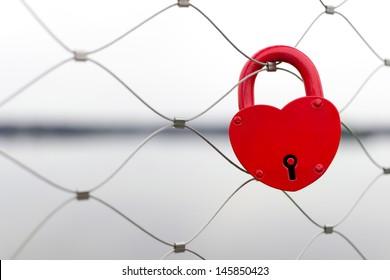 Heart shaped love padlock - beautiful wedding day custom. Shallow depth of field