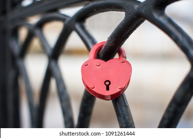 Heart shaped love padlock at the bridge symbolizing a strong marriage