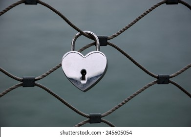 Heart shaped love padlock in Paris. Valentine's day background.